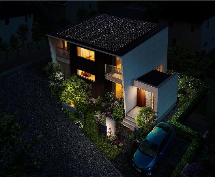 明かりのついた家の外観